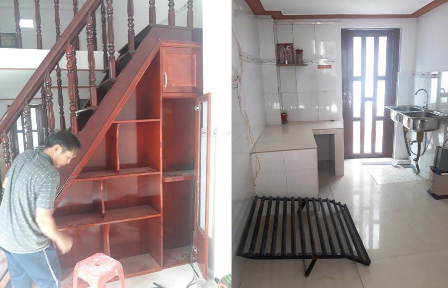 Tủ gỗ dưới cầu tháng, tiết kiệm diện tích và khu vực bếp.
